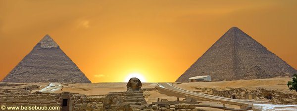 An artist's depiction of the sun setting between the two Great Pyramids and crowning the Sphinx on the summer solstice.